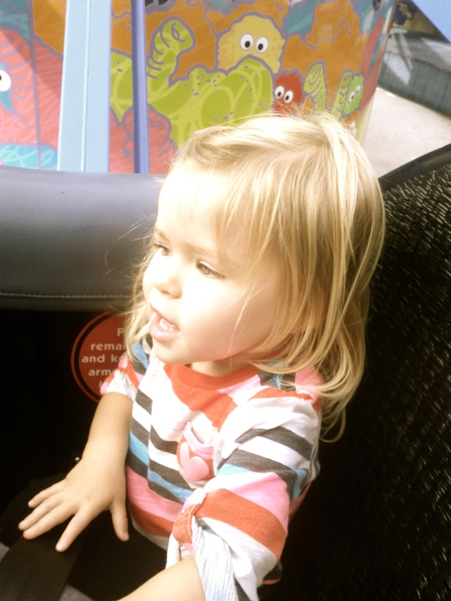 But she did go on her first ride. Up high, round & round. She LOVED it! My lil' thrill seeker!