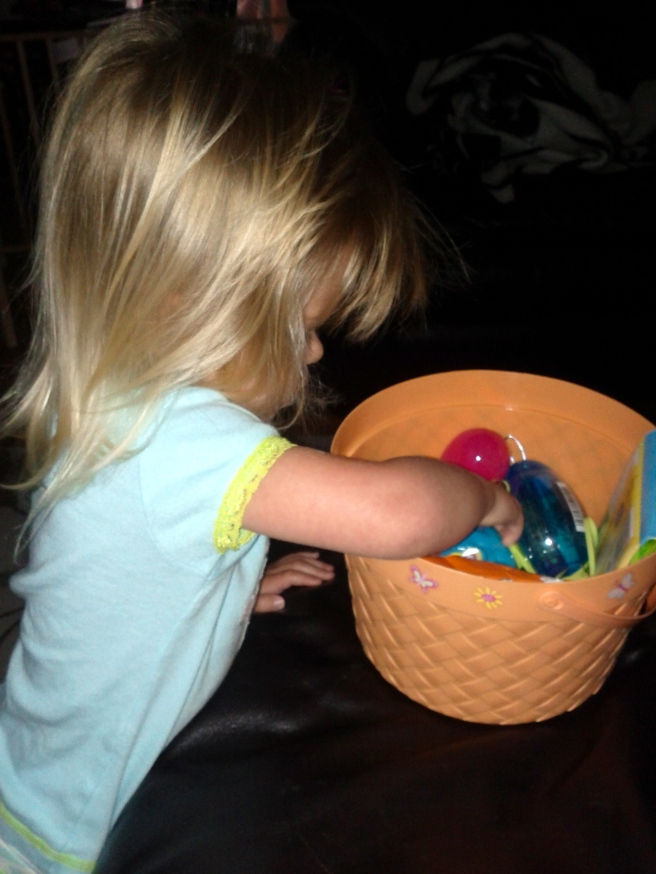 Checking out her Easter bunny loot